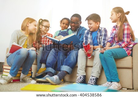Reading in group - stock photo
