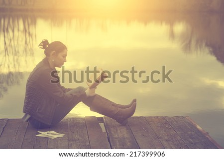 Reading in sunset - stock photo