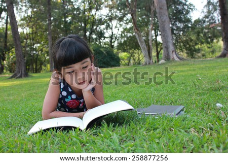 Reading in the park - stock photo