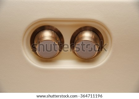Reading lights on the plane - stock photo