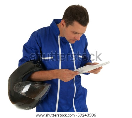 reading map motorcyclist in blue coveralls with black helmet