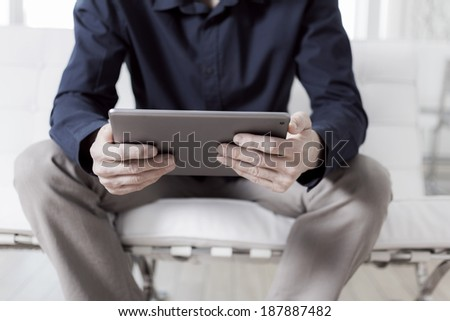Reading on a tablet pc - stock photo