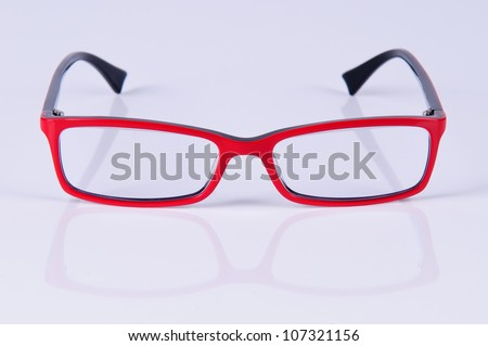 reading red glasses. close-up. on a light gray background