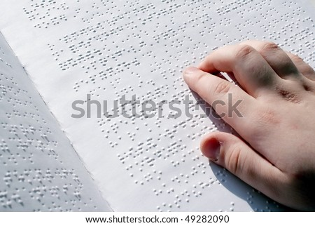 Reading the book Braille - stock photo