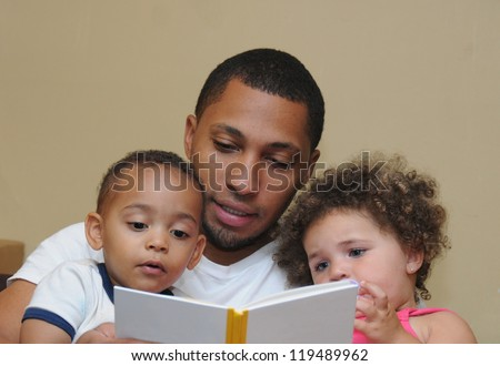 Reading Two Generation Family Father Son with dirty face and Niece Blue Eyes - stock photo