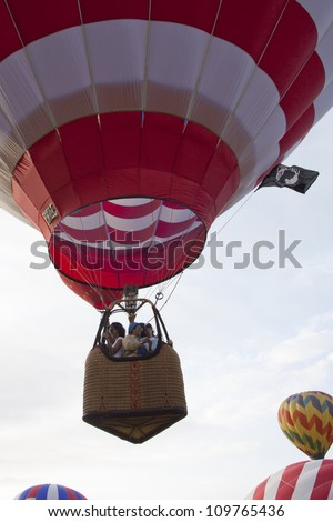 READINGTON, NJ-JUL 29: Passengers stand in the gondola of the Freedom Flyer hot air balloon as it ascends at the Quick Chek New Jersey Festival of Ballooning on July 29, 2012 in Readington, NJ.