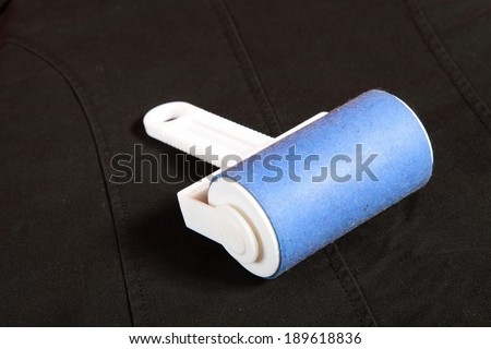 ready cleaning dust with lint roller - stock photo