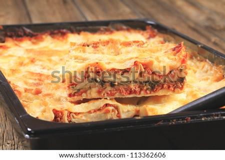 Ready lasagna in a baking pan - stock photo