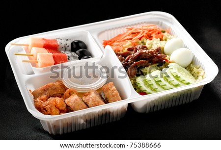 Ready to eat asian rice box full of ingredients that the organs needs - stock photo