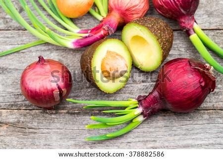 Ready to eat avocado and onions - stock photo
