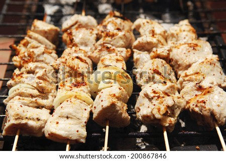 ready to eat smoked fresh hot grilled chicken shish kebab barbecue on grid over charcoal - stock photo