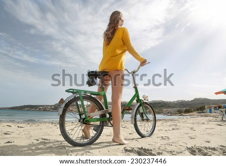 Ready to ride a bike on the sand  - stock photo