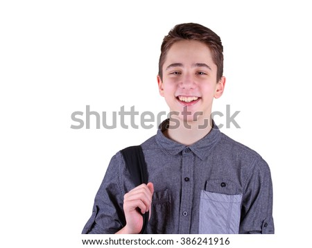 Ready to study. Handsome teenager carrying backpack on one shoulder and smiling, isolated on white background - stock photo