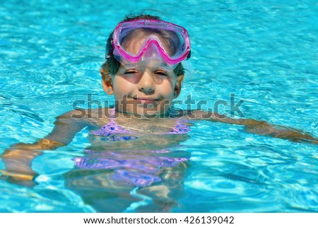 Real adorable toddler girl enjoying her summer vacation