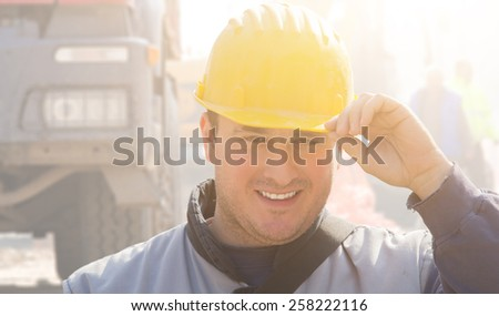 Real and ordinary construction worker on his job. - stock photo