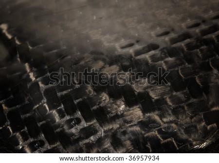 Real authentic carbon fiber textile background - stock photo