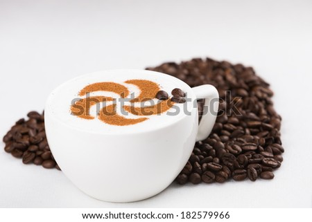 Real capuccino decorated with coffee beans - stock photo
