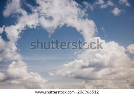 real clouds in the shape of heart. - stock photo
