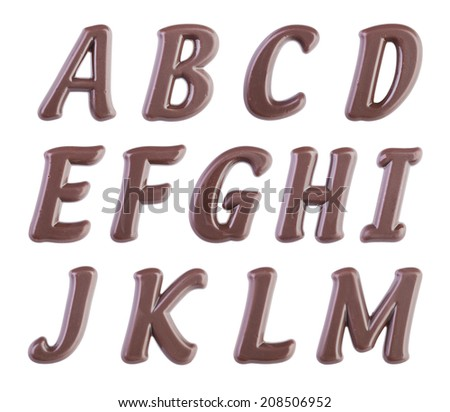 Real dark chocolate alphabet isolated on a white background - stock photo