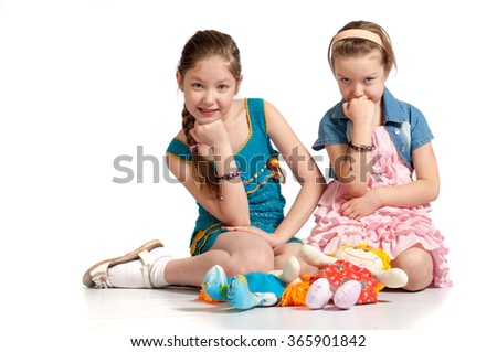 Real emotions. Nice smiling little girl. Funny little girl. Good for borders of articles or websites. Beautiful caucasian model. Isolated on white background. - stock photo