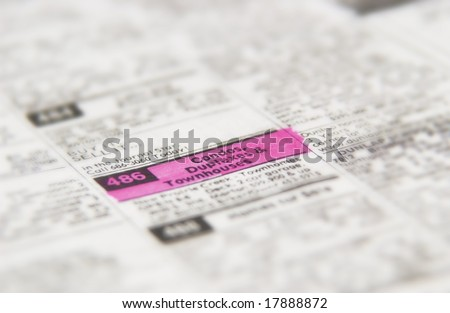 Real estate ad in classified section of newspaper - stock photo