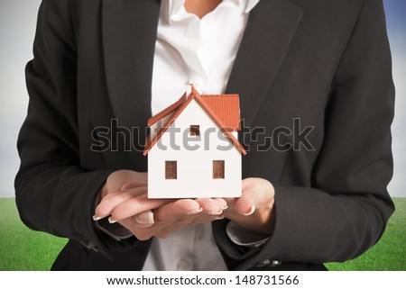Real estate agent and new home concept - stock photo
