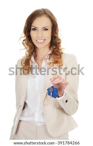 Real estate agent giving keys.  - stock photo