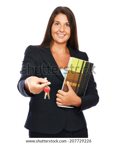 Real estate agent giving the keys to the buyer.   Isolated on a white background.  - stock photo