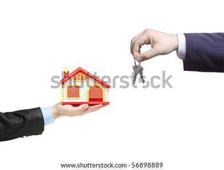 Real estate agent holding keys from your new home - stock photo