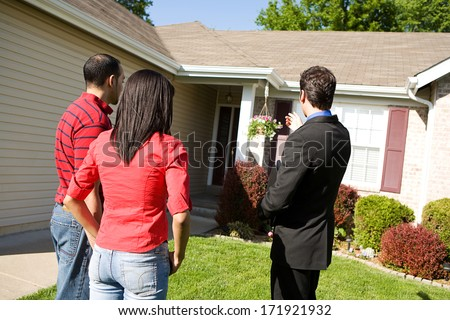 Real Estate: Agent Shows Home To Home Buyers - stock photo