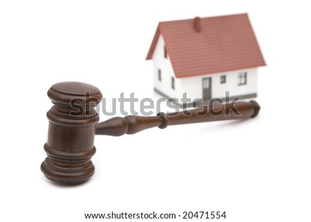 real estate and laws concept with gavel and house