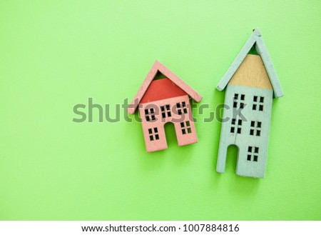 Real estate and property concept, models of houses, selling and buying