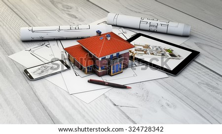 real estate, architecture or interior design concept: digital generated devices and house mock-up with plots  - stock photo