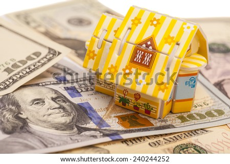 Real estate business concept. House on U.S. dollars  - stock photo