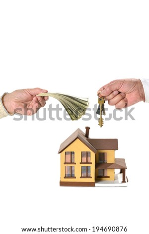 Real estate concept man and woman hands holding keys and dollars at miniature house. isolated on white - stock photo