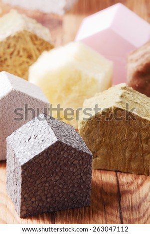 Real Estate Concept - Various Small Colored House Blocks on Top of Brown Wooden Table - stock photo