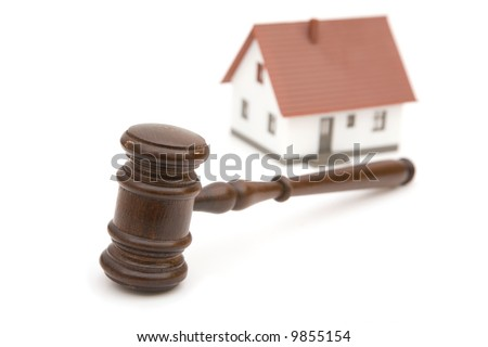 real estate concept with mini house and gavel on white