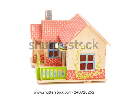 Real Estate Concept.Wooden house on white background - stock photo
