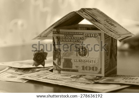 Real Estate dollar house background - stock photo