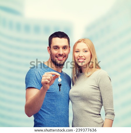 real estate, family and couple concept - smiling couple holding keys - stock photo