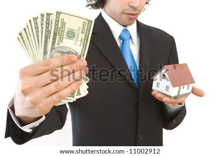 real estate finance concept with mini house and US dollars - stock photo