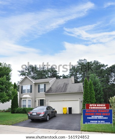 Real Estate For Sale Open House Sign Front yard Lawn Suburban Home Parked Car Blacktop Driveway Residential Neighborhood USA Blue Sky Clouds  - stock photo