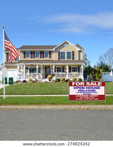 Real estate for sale open house welcome sign Beautiful McMansion home sunny blue sky day residential neighborhood USA - stock photo