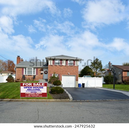 Real estate for sale open house welcome sign Beautiful Suburban Brick Snout style home landscaped yard residential neighborhood USA blue sky clouds - stock photo