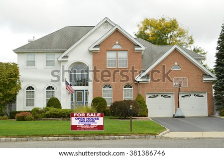 Real estate for sale open house welcome sign Suburban Brick Brownstone McMansion Home Overcast Day Residential neighborhood USA - stock photo