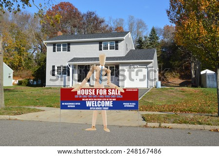 Real estate for sale open house welcome sign Suburban Gray High Ranch home autumn day residential neighborhood clear blue sky day USA