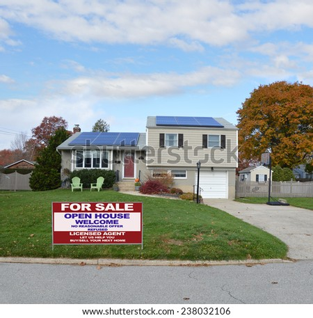 Real Estate for sale open house welcome sign Suburban high ranch house autumn day residential neighborhood blue sky clouds USA - stock photo
