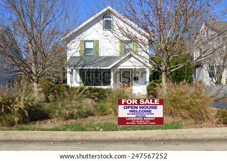 Real estate for sale open house welcome sign suburban home ornamental grass autumn day residential neighborhood USA