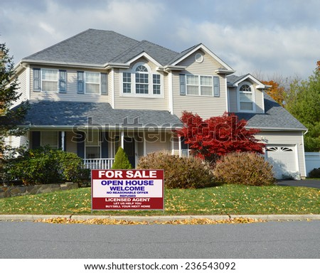 Real Estate for sale open house welcome sign Suburban McMansion style home autumn day residential neighborhood USA