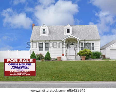 Real Estate for sale sign front yard lawn White Suburban bungalow home blue sky clouds USA